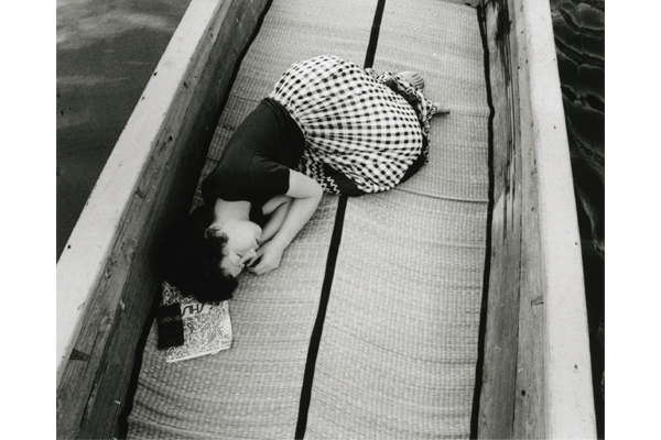 Nobuyoshi Araki, Sentimental Journey, 1971. Araki's career-defining image of his wife during their honeymoon that presentiments her death when the only letters visible from her Shiseido catalogue is 'shi' to mean 'death' in Japanese - Courtesy of Taka Ishii Gallery