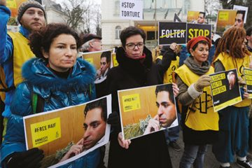 An Amnesty International vigil for Raif Badawi in Vienna, Austria. January 2015. The Saudi arabian government sentanced Raif Badawi to 10 years in prison and 1,000 lashes in May 2014. He was convicted of insulting Islam through his writings and on his website, which was set up to encourage public debate