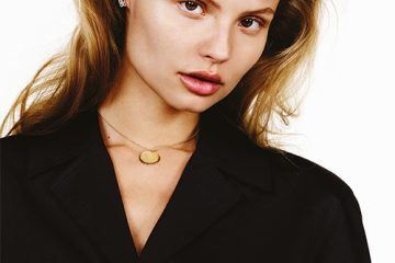 Enchanted Lotus earrings in pink gold with white diamonds, De Beers. Gold necklace, Magdalena Frackowiak Jewellery. Top, Saint Laurent by Hedi Slimane.