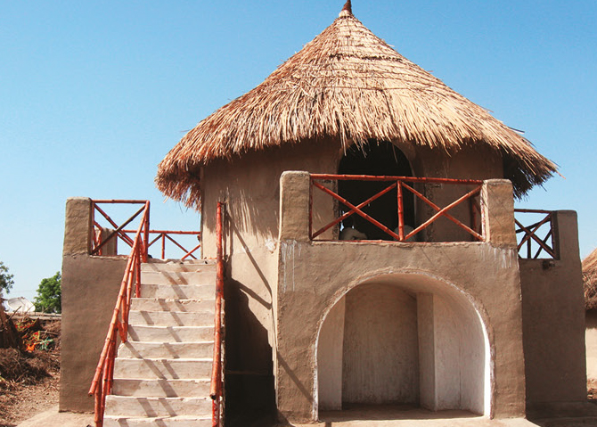 Story Glass Pakistan Centre in Moak Sharif Eco Village with earth walls, bamboo and thatch conical traditional roof, Photograph courtesy of the Heritage Foundation