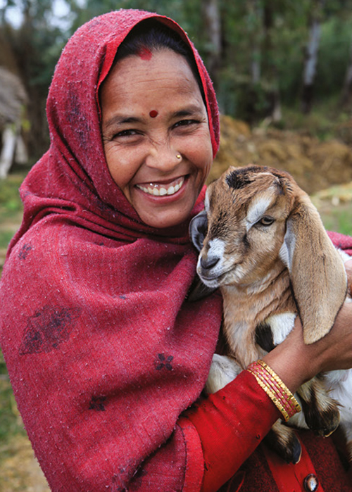 Story picture Good for change A Nepalese farmer from the village of Sitapur who has received a goat from Heifer International, Photo by Russell Powell